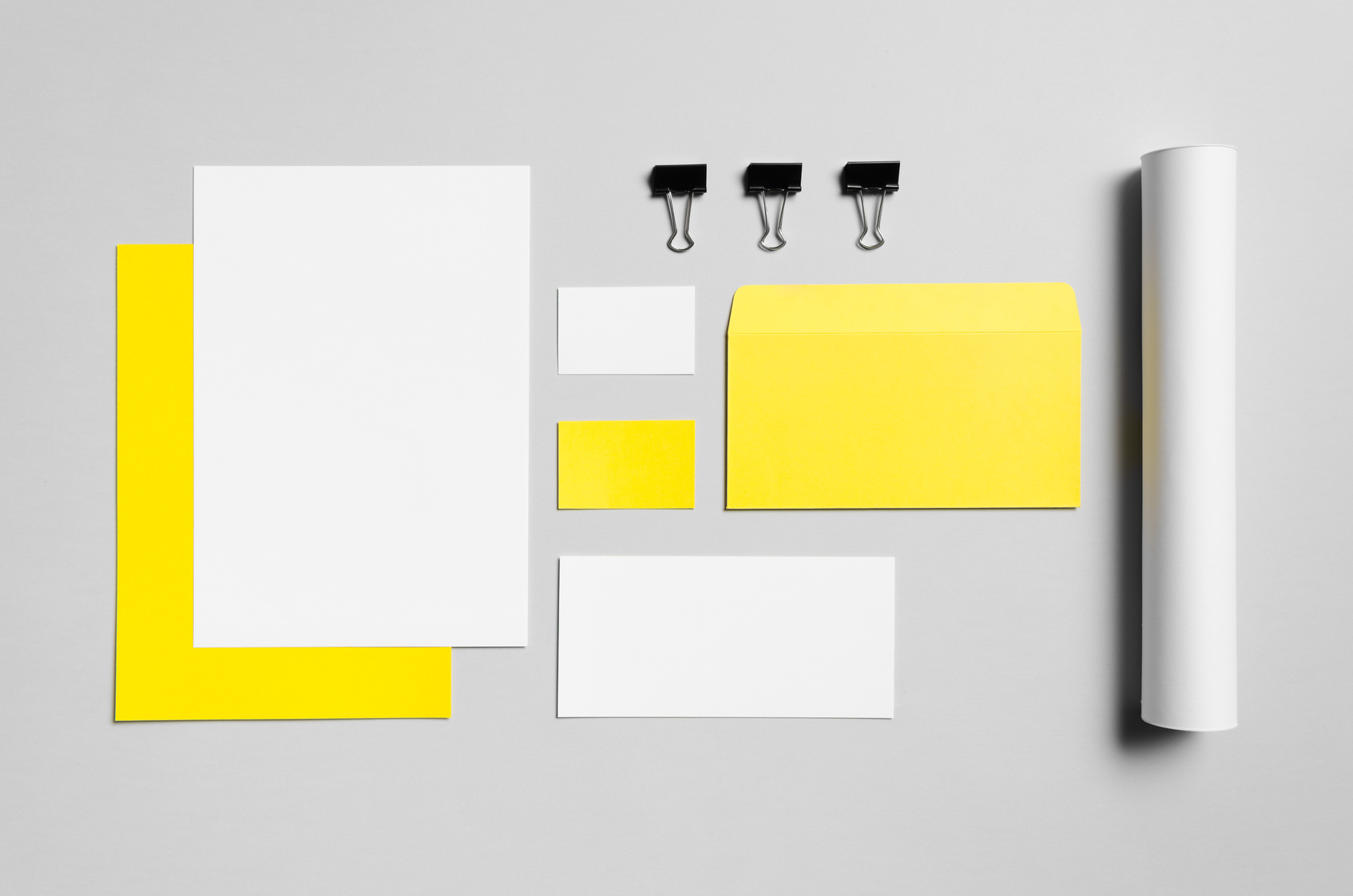 Branding / Stationery Mock-Up - Yellow & White - Letterhead (A4), DL Envelope, Compliments Slip (99x210mm), Business Cards (85x55mm), Mailing Tube